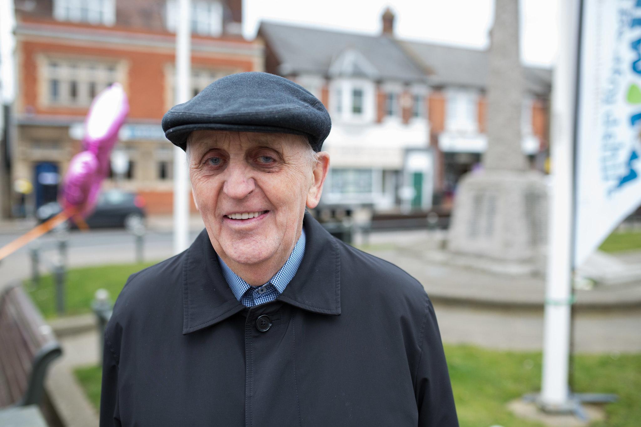 Elderly man smiling at the camera