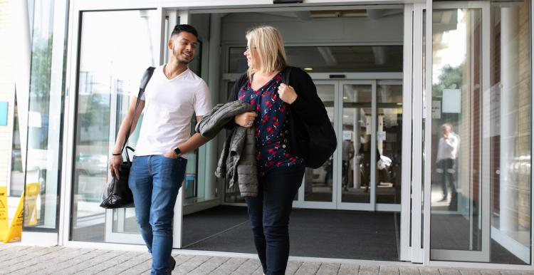 Young man and woman leaving hospital together