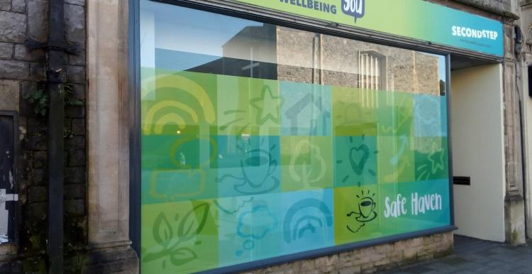 The outside of the Safe Haven shop front. Text on the sign reads: North Somerset Wellbeing and Second Step