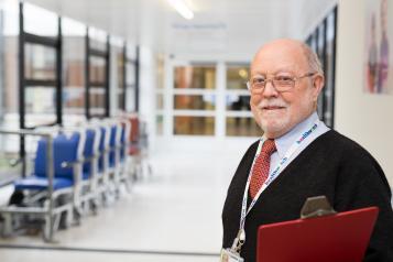 gentleman standing in a hospital corridor