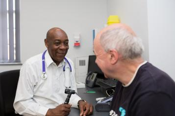 Man talking to his GP in consulting room
