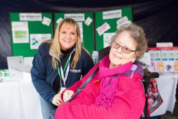 Lady in her wheelchair with a Healthwatch volunteer