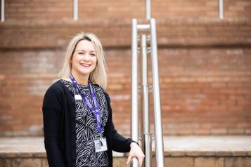 Woman stood on the steps outside a hospital