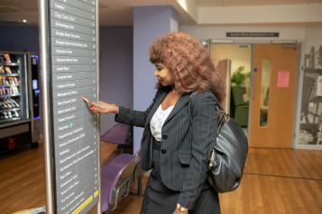Woman looking at hospital sign