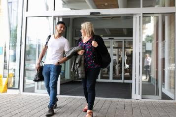 Man and Woman leaving hospital together