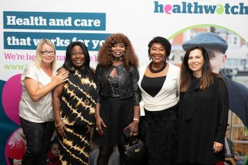 Group of Healthwatch staff posing at a Healthwatch event