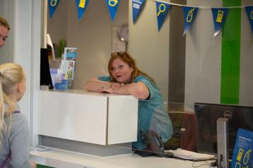receptionist leaning on the desk