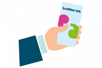 Hand holding a Healthwatch leaflet