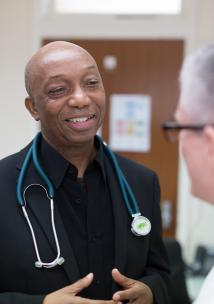GP reassuring his patient